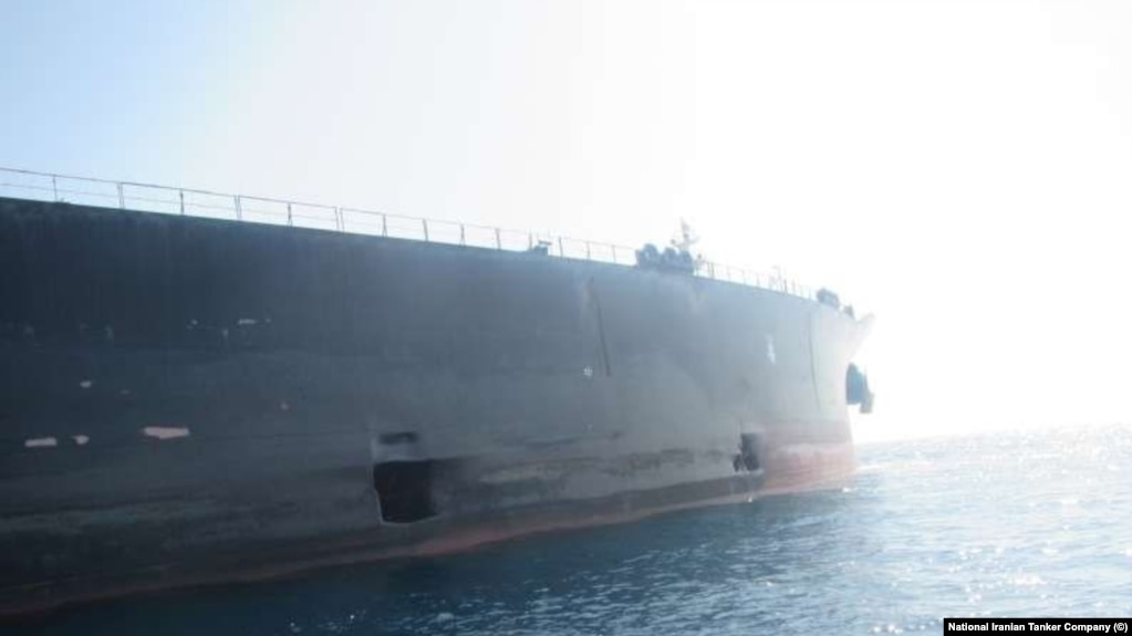 Images released Monday showed a pair of gaping holes in the hull of an Iranian oil tanker that Tehran says was hit by two missiles off the coast of Saudi Arabia in a mysterious attack last week that threatened to ratchet up tensions.