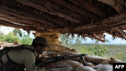 A soldier on guard in a bunker in Pakistan's Kurram tribal district, near the Afghan border
