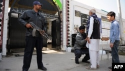 Security measures were already tight ahead of the September 21-22 attacks, including searches as worshipers entered Shi'ite mosques like this one in Islamabad.