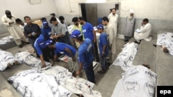 Bodies of victims of the ethnic clashes at a mortuary of a local hospital in Karachi