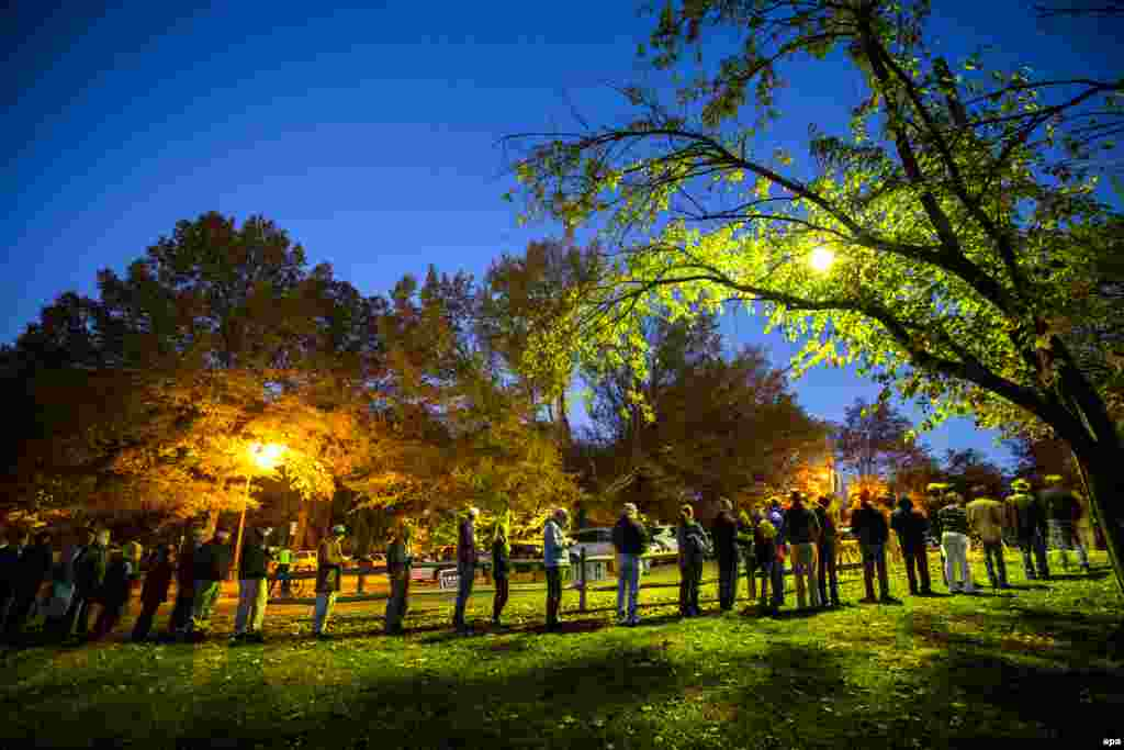 Virginia residents wait in line before the polls open at a historic property called the ''Hunter House'' in Vienna, Virginia.