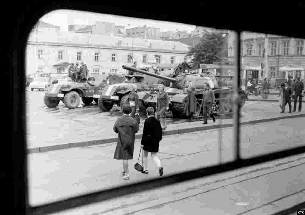 Soviet tanks and armored vehicles guard an area of Republic Square in downtown Prague.