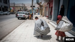 Iran street children forced to do hard work or used for begging.