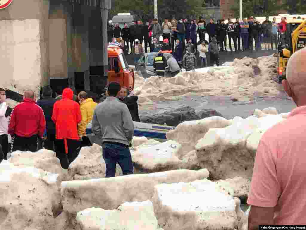 "Chunks of ice were left in Gyumri as the floodwaters subsided.   Although summer hail is relatively common in the mountain city, which sits at an altitude of 1,500 meters, a local meteorologist described the storm as ""unprecedented."""