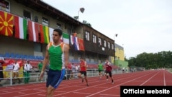 Iraqi paralympic athlete Fadhil Razzaq Abdulameer crosses the finish line to win gold in the 100 meters