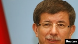 Turkish Foreign Minister Ahmet Davutoglu (in file photo) reportedly met with Israeli Trade Minister Binyamin Ben Eliezer.