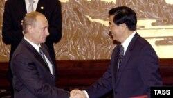 Владимир Путин и Ху Цзинтао: реакция на американскую дружбу с Индией?