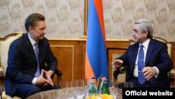Armenia -- President Serzh Sarkisian (R) meets Gazprom Alexei Miller, Yerevan, 26 February, 2014.