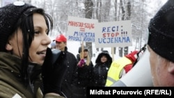 Protesters on February 16 decry the events that prompted the resignation Suljagic's resignation.