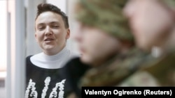 A defiant Nadia Savchenko attends a court hearing in Kyiv on March 23.