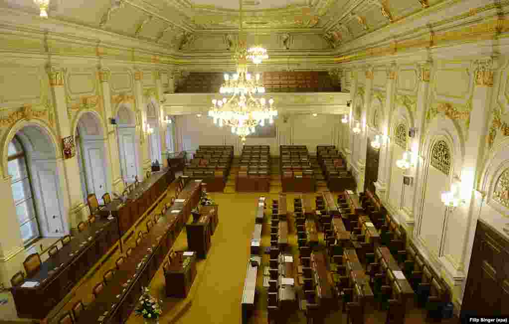 The empty Czech lower house of parliament after a vote on the dissolution of the legislative body in Prague on August 20. A caretaker government led by Jiri Rusnok lost a vote of confidence on August 7. The parliament voted to dissolve itself on August 20, paving the way for the early elections.