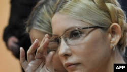 Yulia Tymoshenko listens as the judge reads the verdict on her case in a district court in Kyiv on October 11.