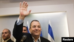 Israeli Defense Minister Ehud Barak waves as he leaves a news conference in Tel Aviv on November 26.