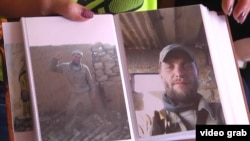 "Yelena Matveyeva shows photos of her husband, Stanislav, who is thought to have died fighting in Syia. ""Wherever they sent them, there was no defense. They just threw them into battle like pigs,"" she contends. ""The government should avenge them somehow."""