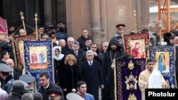Armenia - President Serzh Sarkisian and his wife Rita walk out of the Echmiadzin cathedral after the Christmas Mass, 6Jan2014.