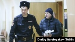 Roskosmos director Vladimir Yevdokimov (right) was arrested in December on suspicion of fraud.
