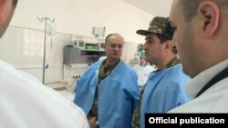 Nagorno-Karabakh - Armenian Defense Minister Seyran Ohanian visits a military hospital in Stepanakert, 21Mar2015.