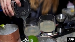 A bartender fills glasses at a promotional event in Chicago in May of Russian Standard Vodka, which is targeted along with Stolichnaya by the U.S.-based boycott to protest Russia's antigay legislation.
