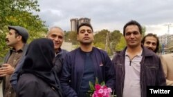 Esmail Bakhshi (C) with his family and friends after his release on bail. October 30, 2019.