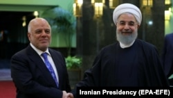 Iranian President Hassan Rohani (right) meets with Iraqi Prime Minister Haidar al-Abadi in Tehran on October 26.