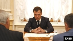 Medvedev has joined the leaders of Abkhaz and South Ossetia (foreground) in signing off on the cease-fire