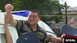 Ramazan Esergepov being escorted by police to the courthouse in Taraz on August 8.