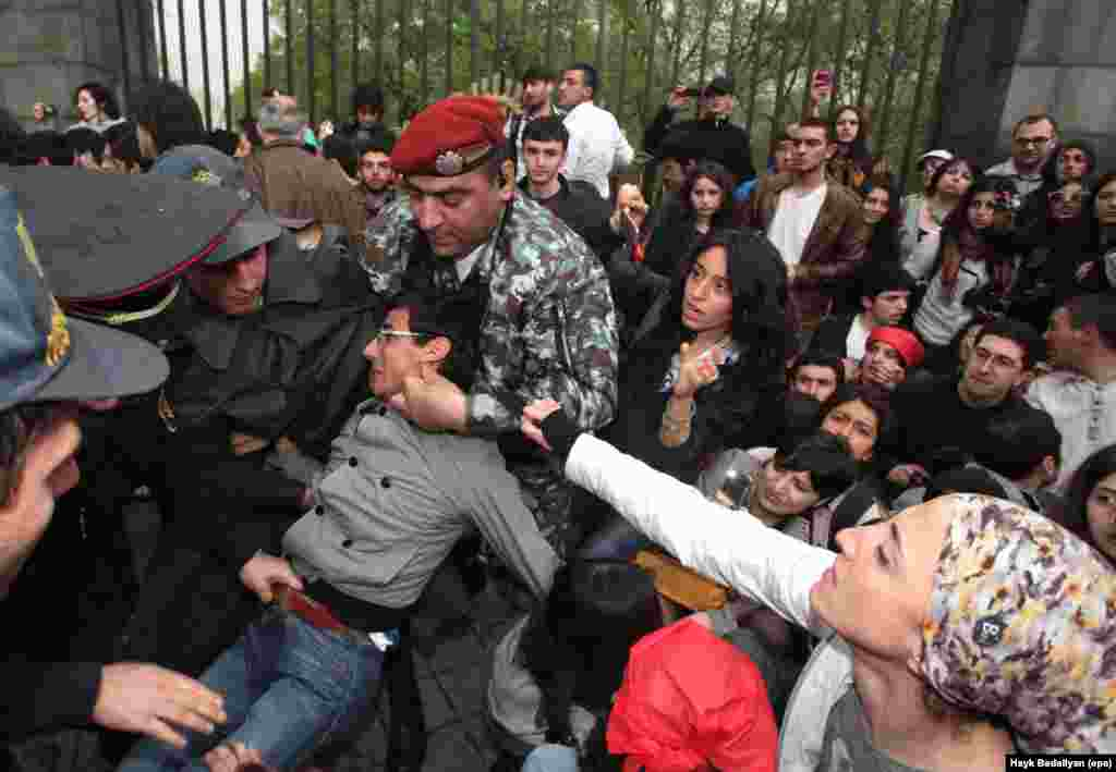 Armenian police detain a supporter of opposition leader Raffi Hovannisian during a protest in Yerevan following the inauguration of Armenian President Serzh Sarkisian for a second term on April 9.