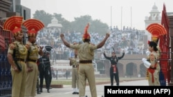 FILE:Indian Border Security Force personnel (brown) and Pakistani rangers (black) take part in the daily beating of the retreat ceremony at the India-Pakistan Wagah border crossing