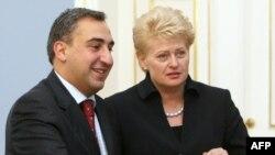 Georgian Prime Minister Nika Gilauri (left) meets with Lithuania President Dalia Grybauskaite in Vilnius.