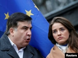 Former Odesa Governor Mikheil Saakashvili (left) and Yulia Marushevska, former head of the Odesa customs office, both resigned from their posts, accusing President Petro Poroshenko of corruption and a lack of political will.