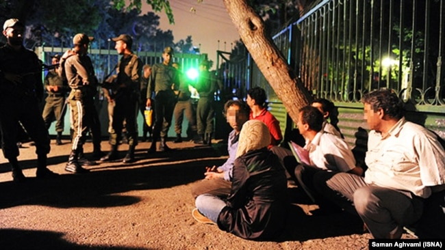 Several people arrested by Iranian police after participating in a party in Tehran, undated.