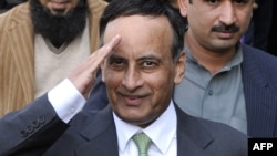 Pakistan's former ambassador to U.S. Husain Haqqani gestures as he leaves The High Court Building in Islamabad, 09Jan2012