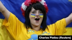 UKRAINE – Ukrainian soccer fan cheers before the Group D Euro 2012 soccer match against France at the Donbass Arena in Donetsk, June 15, 2012
