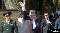 "Ukrainian President Petro Poroshenko waves to cadets at a military academy in Kyiv on September 1. Poroshenko said the events of the past few days show Russia has launched a ""direct and open aggression"" against Ukraine."