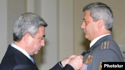 Armenian President Serzh Sarkisian decorates a senior police official on April 16, 2009