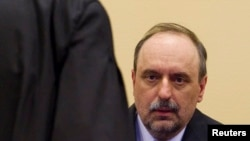 Goran Hadzic during his initial appearance to stand trial on crimes against humanity at the International Criminal Tribunal for the former Yugoslavia (ICTY) in The Hague in 2011.