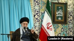 Iranian Supreme Leader Ayatollah Ali Khamenei gestures as he delivers a speech in Mashad, March 21, 2018