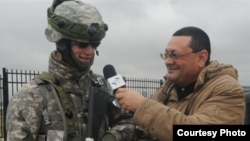Корреспондент Радио «Голос Америки» и информационного агентства Turan Тапдыг Фархадоглу. Архивное фото, 2013.