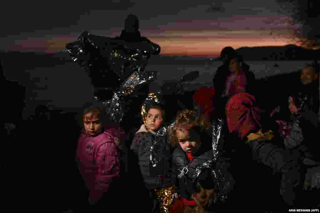 Migrant children wait near Skala Sykamineas on the Greek island of Lesbos after crossing the Aegean sea between Turkey and Greece on March 1.