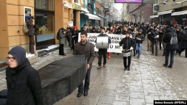 The group held a symbolic funeral for human rights in Sarajevo on December 10.