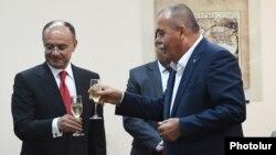 Armenia - Defense Minister Seyran Ohanian (L) and Yerkrapah Union leader Manvel Grigorian at a signing ceremony in Yerevan, 9 September 2014.