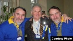 Збіґнєв Буяк та брати Капранови під час форуму Євромайданів у Харкові, 12 січня 2014 року