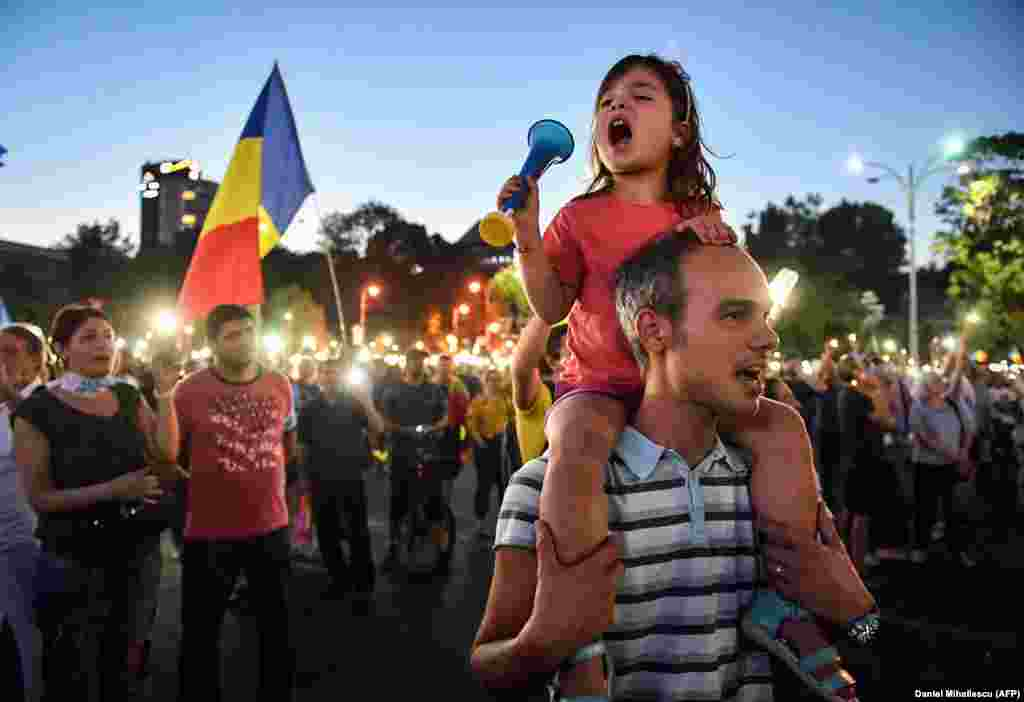 "The crowds rallied after calls went out over social media for ""all Romanians [to] come to Bucharest!"""