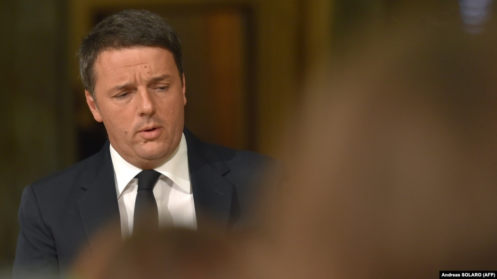 Italy's Prime Minister Matteo Renzi arrives to announce his resignation during a press conference at the Palazzo Chigi following the results of the vote for a referendum on constitutional reforms on December 4.