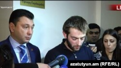Armenia - Student activist David Petrosian (center) and Deputy Parliament Speaker Eduard Sharmazanov talk to reporters after their meeting, 15Nov, 2017