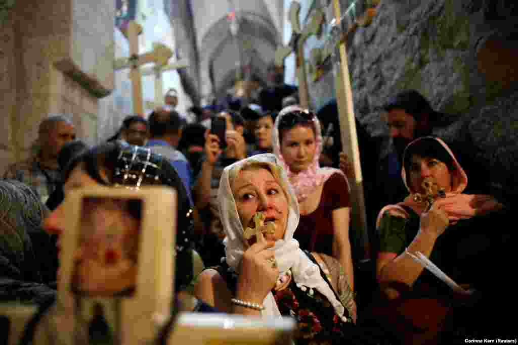 Orthodox Christian worshippers hold crosses as they take part in a Good Friday procession in the Church of the Holy Sepulchre in Jerusalem's Old City on April 6. (Reuters/Corinna Kern)
