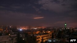 A picture taken early on January 21, 2019 shows Syrian air defense batteries responding to what the Syrian state media said were Israeli missiles targeting Damascus. File photo