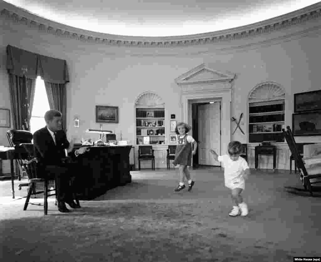 President Kennedy with daughter Caroline and son John Jr. in the Oval Office of the White House on October 10, 1962.