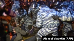 Russian riot police detain activists protesting on May 15 against a plan to build an Orthodox church in a park in the Russian Urals city of Yekaterinburg.