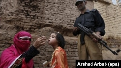 A polio worker administers a polio vaccine to a child in Peshawar. Pakistan is one of a handful of countries where the disease is still endemic.